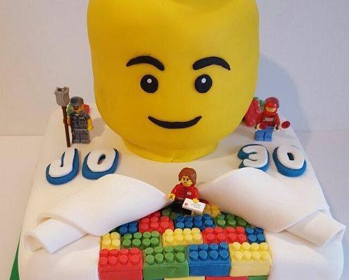 Lego head birthday cake - Quality Cake Company Tamworth