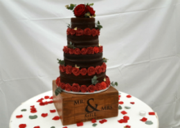 Chocolate Four Tier Naked Wedding Cake With Handmade Roses