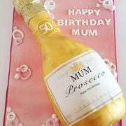 Gold pink prosecco bottle cake