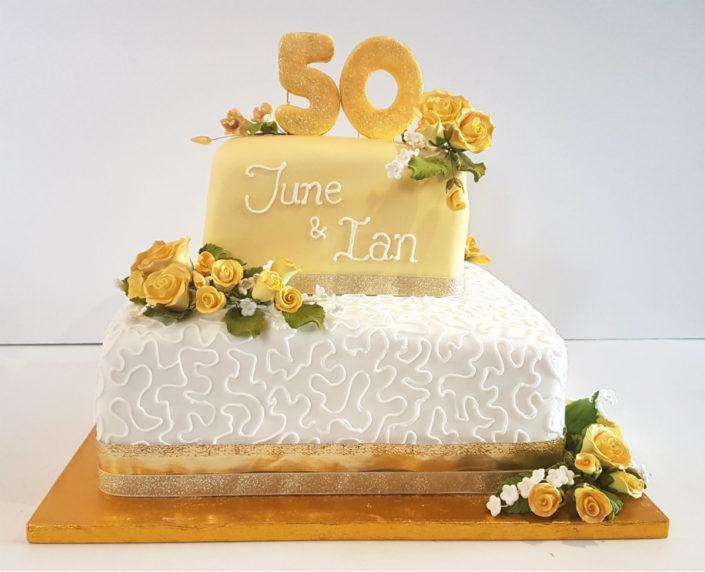 Two tier golden wedding cake