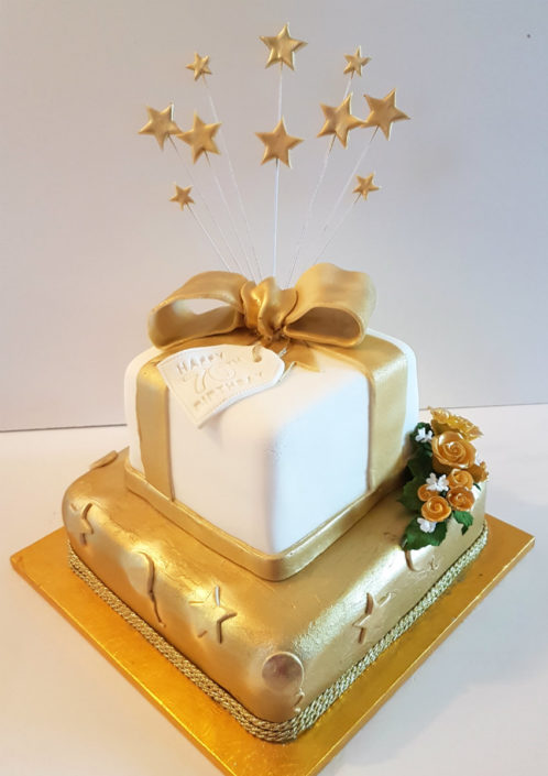 to tier 70th anniversary cake bow and stars gold theme tamworth