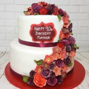 Two tier red and burgundy flower spray birthday cake - tamworth