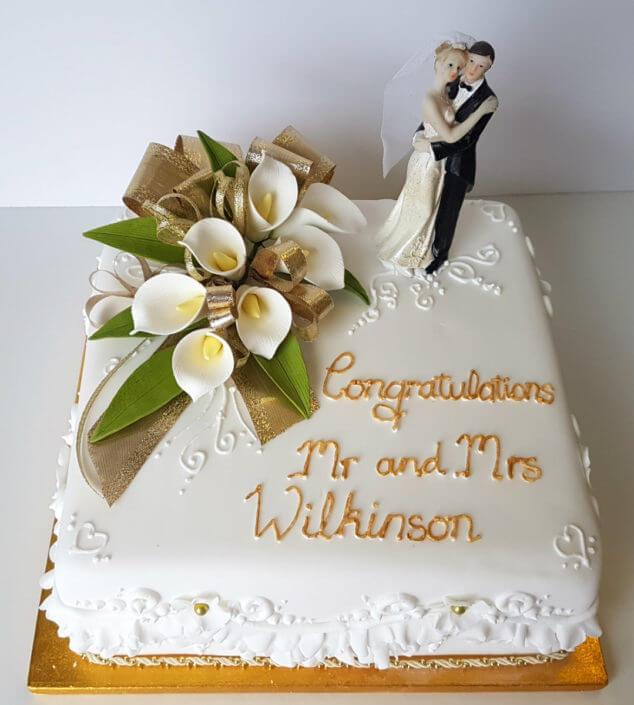 Simple traditional white lily wedding anniversary cake - tamworth