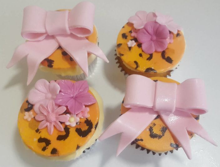 Leopard print cupcakes with pink bows and flowers - Tamworth cupcakes