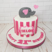 Simple white with pink stripes birthday cake with elephant topper - tamworth