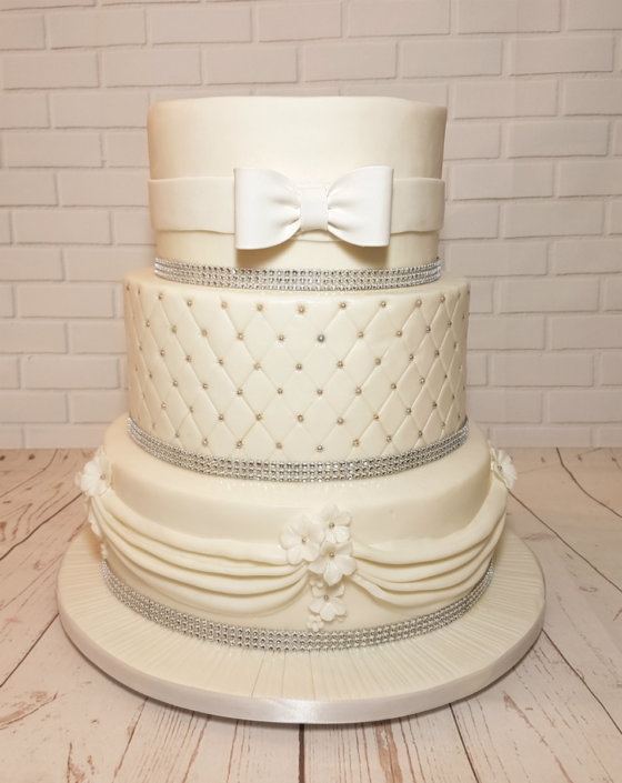 Simple white elegant quilted bow wedding cake - Tamworth Sutton Coldfield